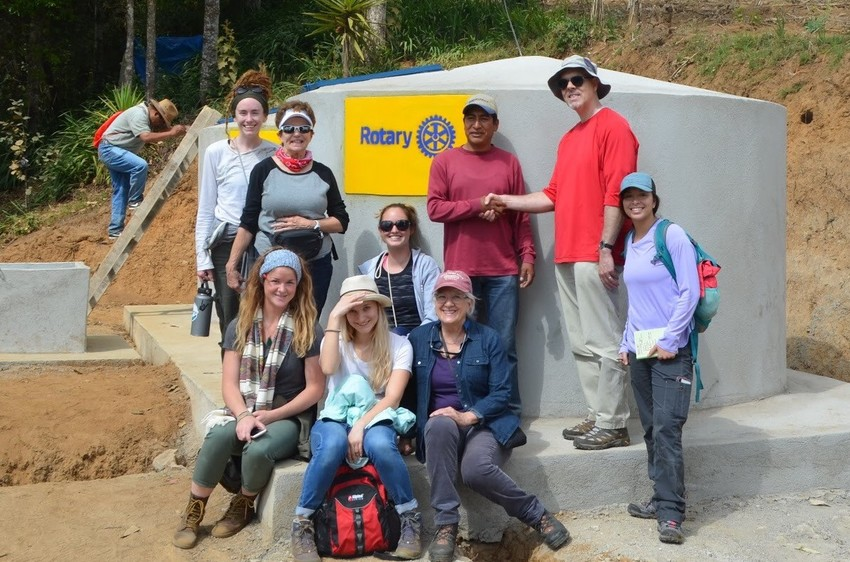 A team of Rotary Club of Ponte Vedra Beach members, University of North Florida engineering students and staff and people of the village of La Esperanza in Guatemala stand with a part of the water distribution system they built in March 2018. Displayed from left to right are: Taylor Broussard, Sherry Mahoney, Amber Slack, Samantha Kovalenko, Piper Austin, Rosemary Takacs, Samuel (last name unknown), Dr. Christopher Brown and Rosemarie Pinto.