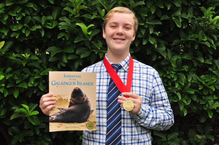 """Ponte Vedra resident and 12-year-old author Grayson Rigby displays the gold medal he received at the 2018 Florida Authors and Publishers Association President's Book Awards for his book, """"Expedition to the Galápagos Islands."""""""