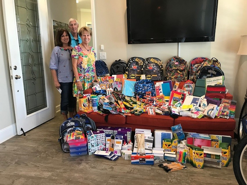 David Weekley Team Members donate school supplies to Investing in Kids (INK) as part of the CA+RE School Supplies Drive.