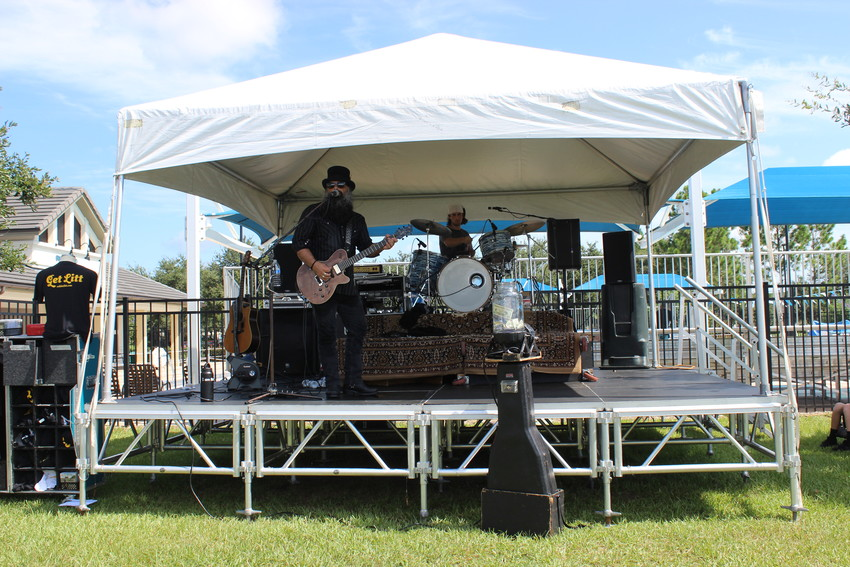 The Robbie Litt Band performs at the Nocatee Farmers Market Aug. 18.