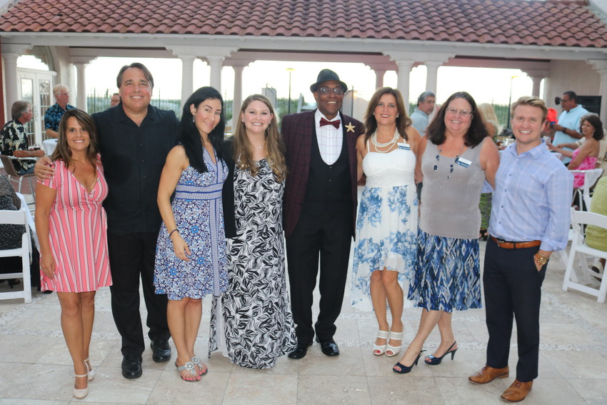 The team from Rock Solid Law gathers at the third annual Sterling's Summer Pier Dance June 13 at Casa Marina Hotel in Jacksonville Beach. Pictured from left to right are: Jennifer Kazebee, John Miller, Yasmin Adamy, Katie DePew, Sterling Joyce of Casa Marina, Tina Kooiker, Lisa Sawyer and Keaton Ocasio.