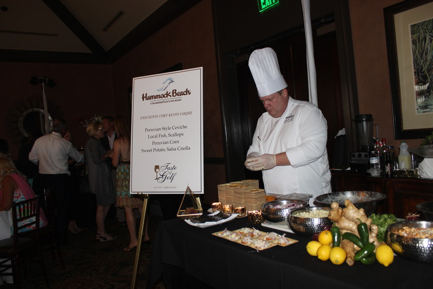 A chef from Hammock Beach prepares food at the event.