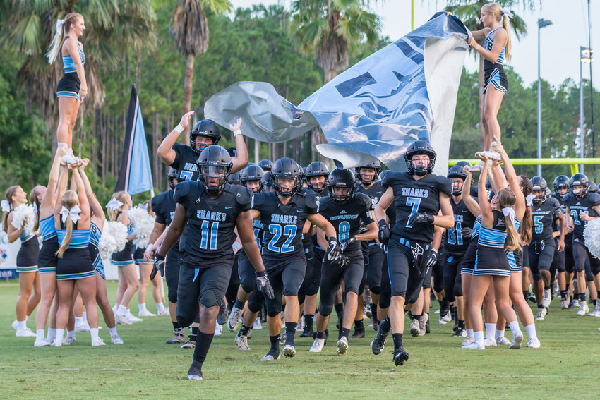 The Sharks storm the field at the beginning of the scrimmage.