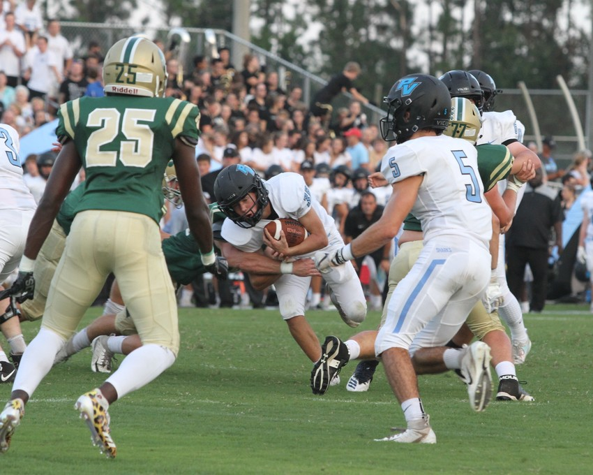 Sharks running back Campbell Parker fights for yardage against Nease in the Aug. 24 rivalry game.