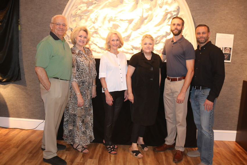 """Len and Sonya Cutter, Lindy Hart, Madeline Kisting and Matthew and Mark Cutter gather in front of a scale model of Frederick Hart's """"Ex Nihilo"""" at the opening reception for the Frederick Hart exhibition at Cutter & Cutter Fine Art's Ponte Vedra Beach gallery."""
