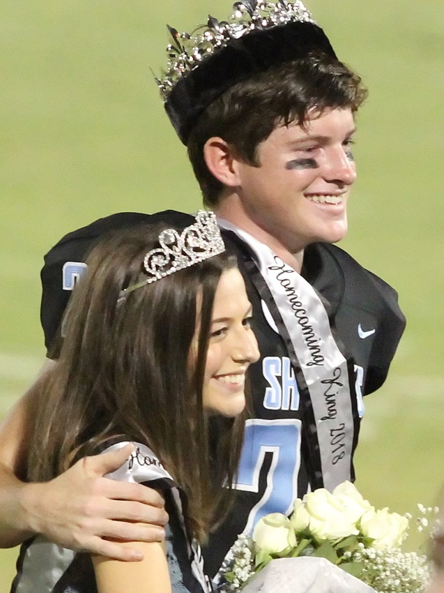 Ponte Vedra High School students Chloe Thomas and Jake Lytle stand together after being named homecoming queen and king at the Sharks' Sept. 21 game against Pedro Menendez.