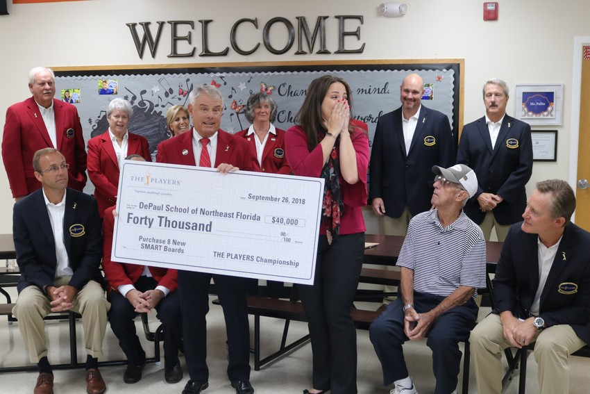THE PLAYERS Championship Red Coats surprise DePaul School Head of School Dr. Amber Oliveira Wednesday, Sept. 26, with the donation of eight new SMART Boards to the school.