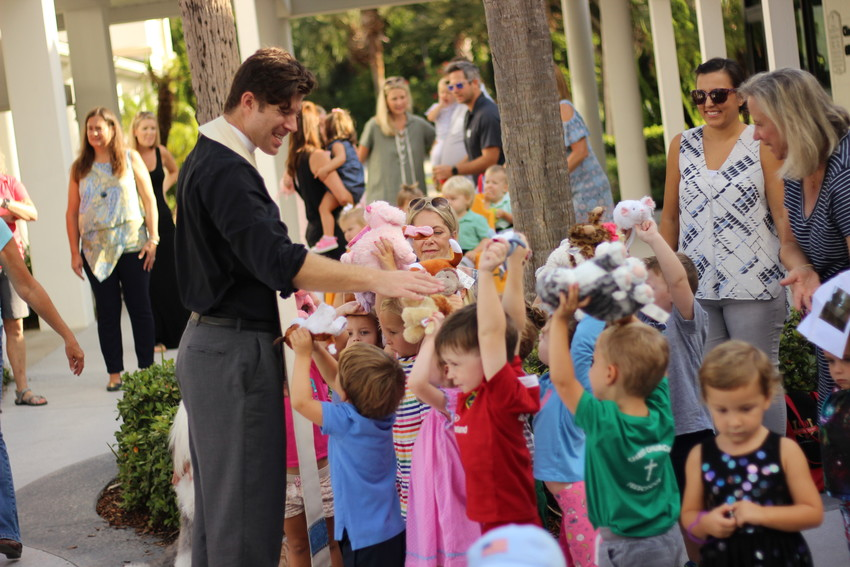 "Christ Episcopal Church Associate Remington Slone participates in the church preschool's ""Blessing of the Pets"" event on Oct. 3."