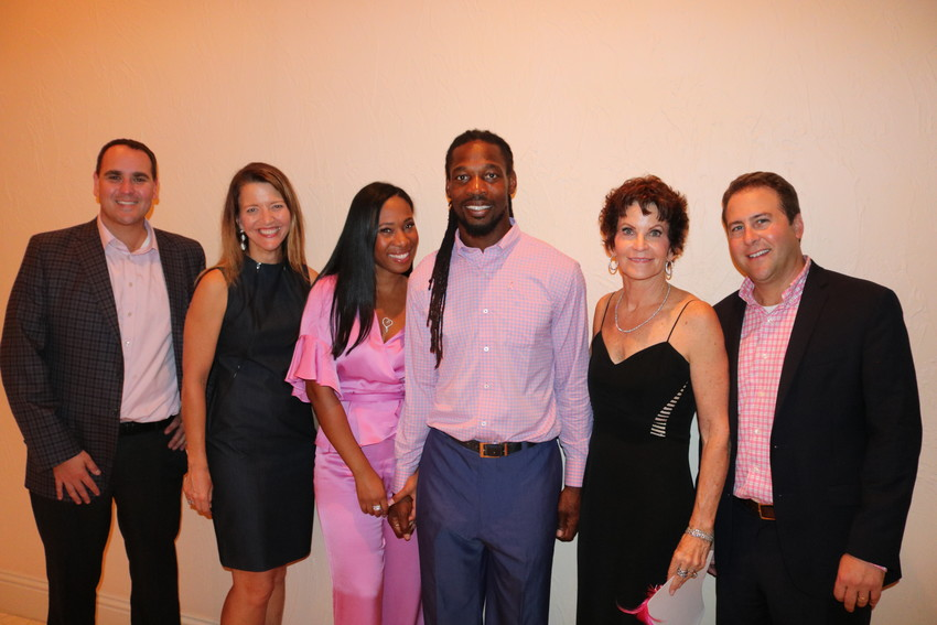 Jarrett Dreicer, vice president of operations for Baptist Health; Sarah Smith, gift officer at Mayo Clinic; Ebony and Rashean Mathis, a former Jacksonville Jaguar; Nancy Morrison, Cocktail Party chair; and Jason Simpson, director of development for Baptist Medical Center Beaches, gather at the Pink Ribbon Cocktail Party on Oct. 11 at the Mathis residence in Marsh Landing Country Club.