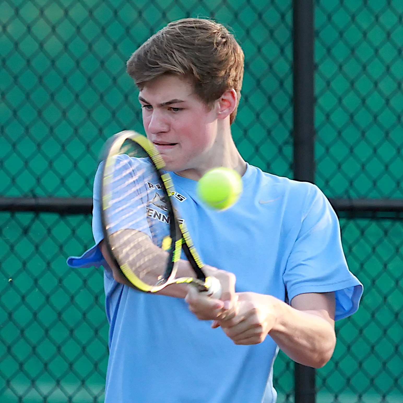 Davis Massey of the Sharks concentrates as he hits a backhand against Bertram.