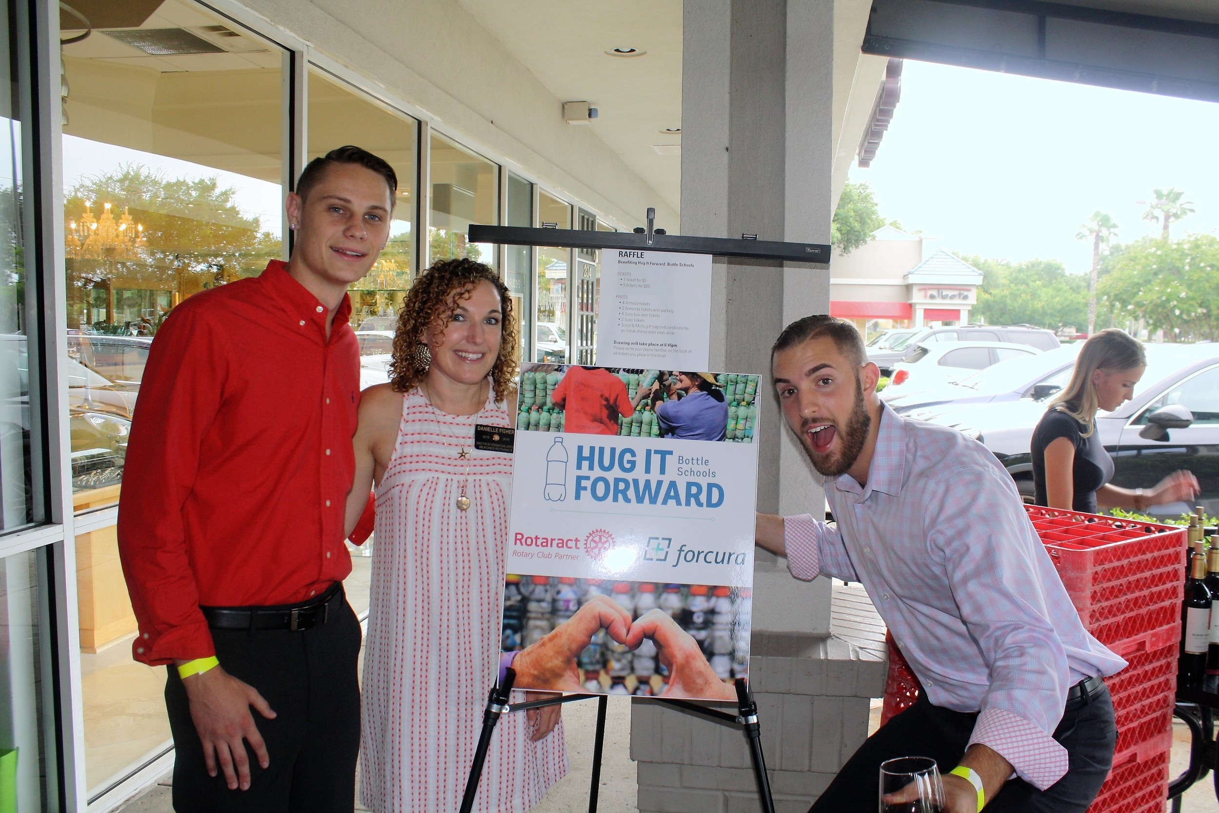 Beaches Rotaract member Danielle Fisher joins Daytona State Rotaract members Justin Gadrim (left) and Michael Tirpak at the wine tasting to raise funds to build a school in Guatemala.