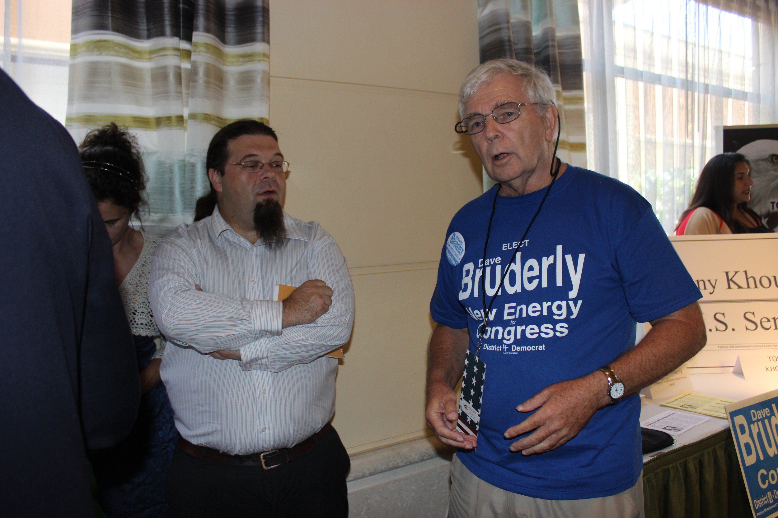 Democratic congressional candidate Dave Bruderly talks with local Democrats.