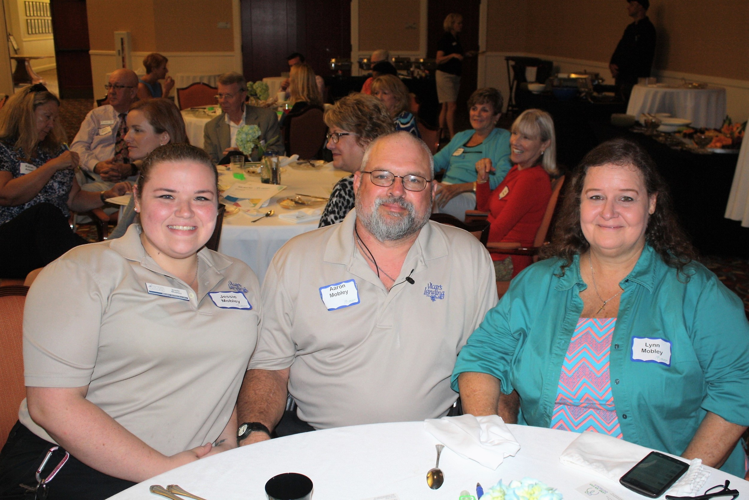 Vicar's Landing Senior Security Officer Aaron Mobley – shown here with daughter Jessie and wife Lynn – was instrumental in forging the partnership between Vicar's Landing and Lend an Ear Outreach, which provided him with much-needed hearing aids.