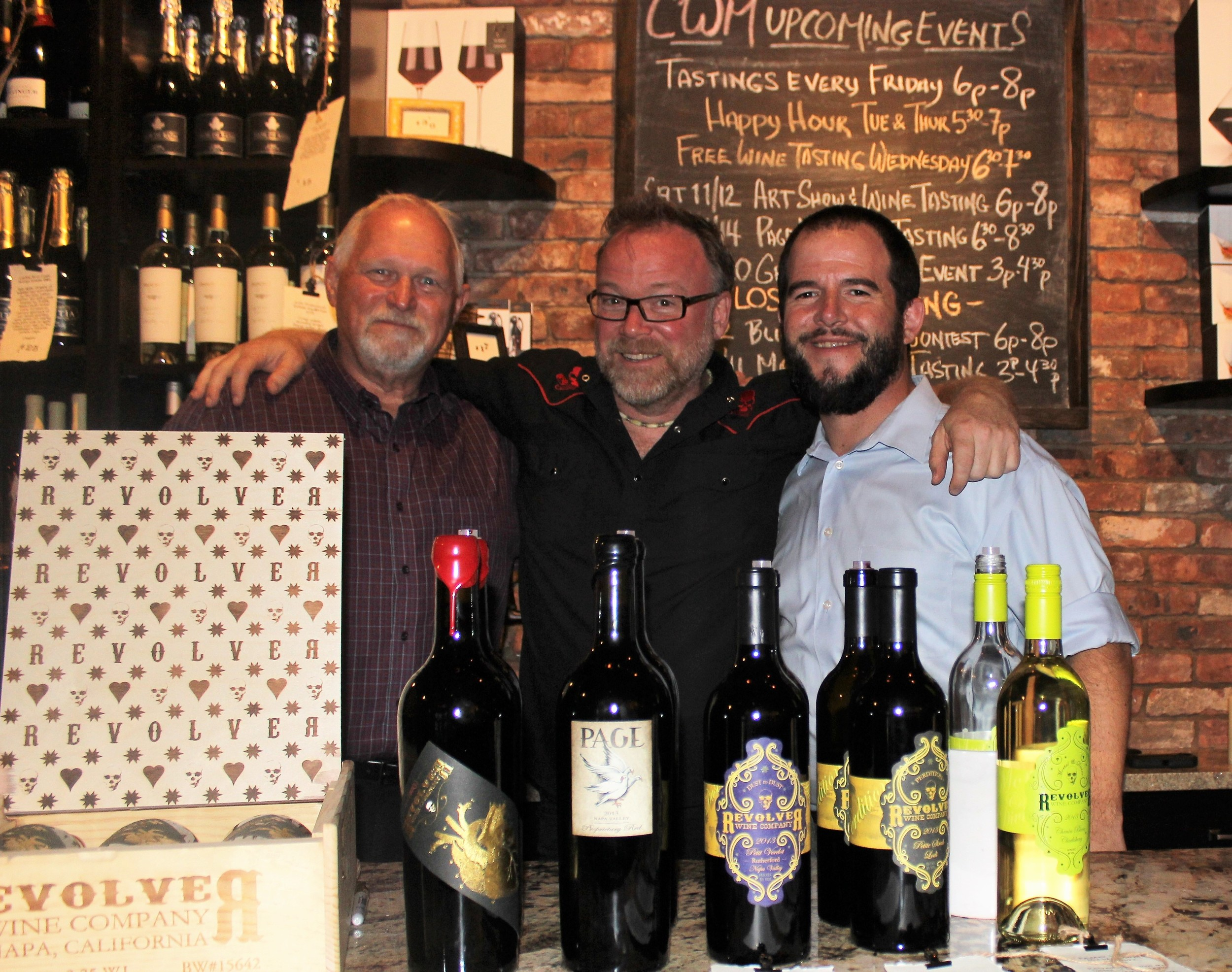 "Revolver Wine Co. winemaker and proprietor Bryan Page (center) with Allen Horne and Steve Lourie of Coastal Wine Market & Tasting Room at the ""Meet the Winemaker"" event Nov. 14 in Nocatee"