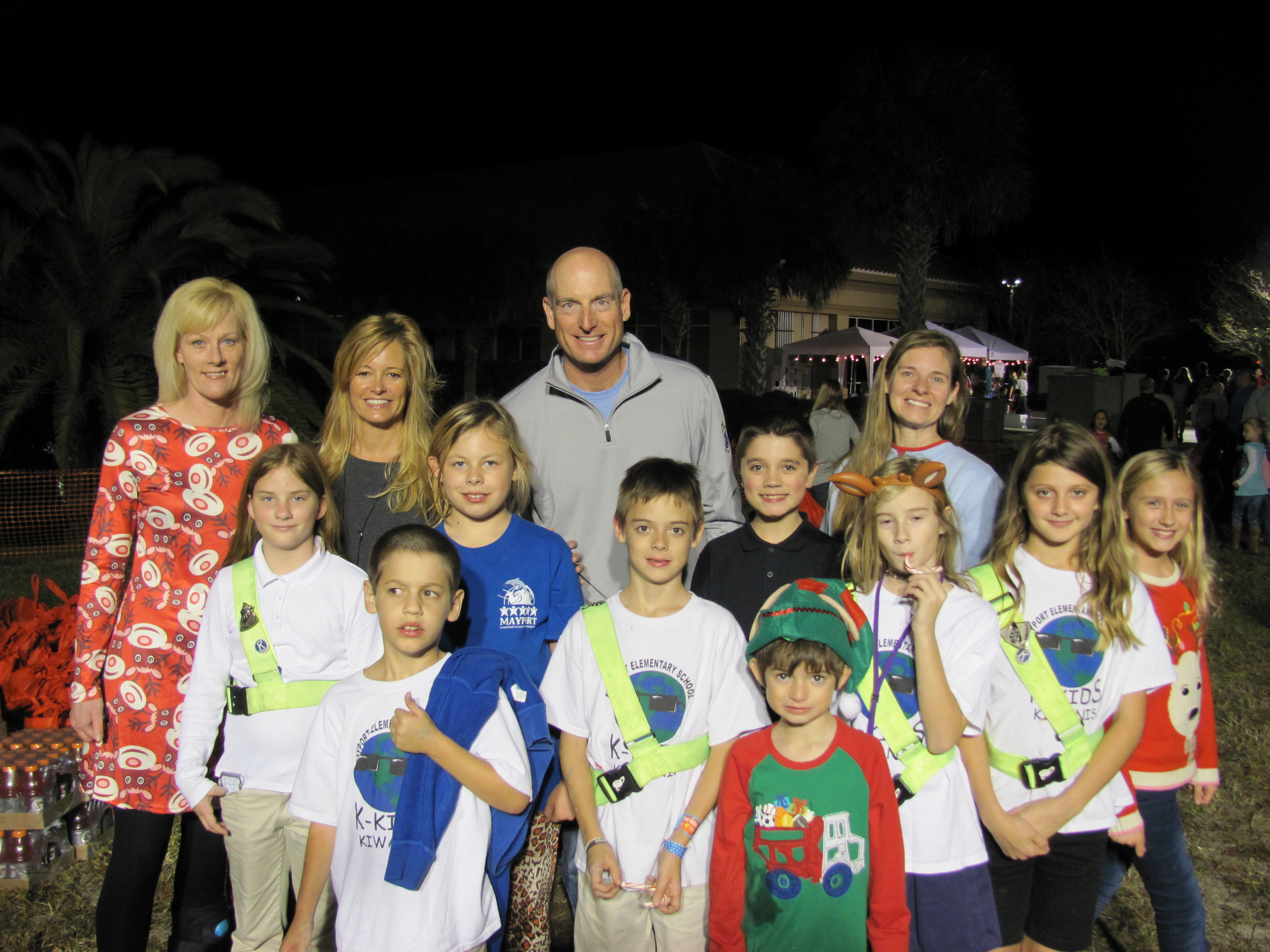 Jim and Tabitha Furyk (center) with a group of volunteers at Hope for the Holidays