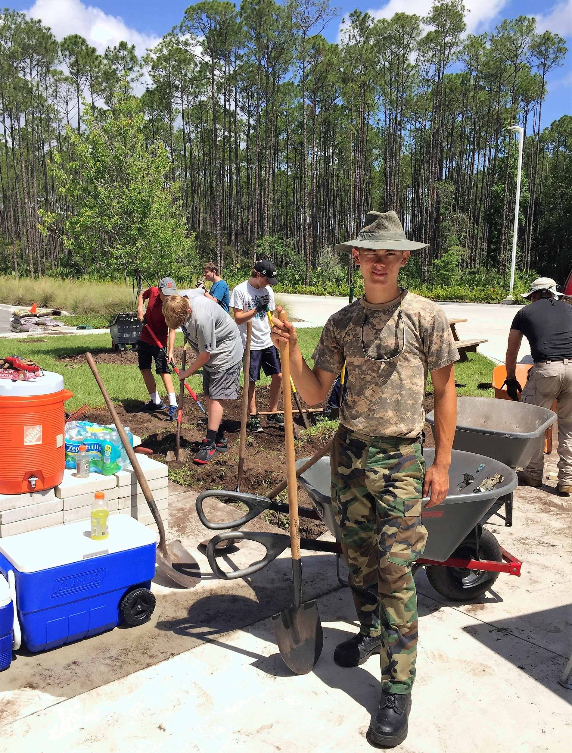 Thomas Houston leads boy scouts in building a patio at the Nocatee fire station for his Eagle Scout community service project