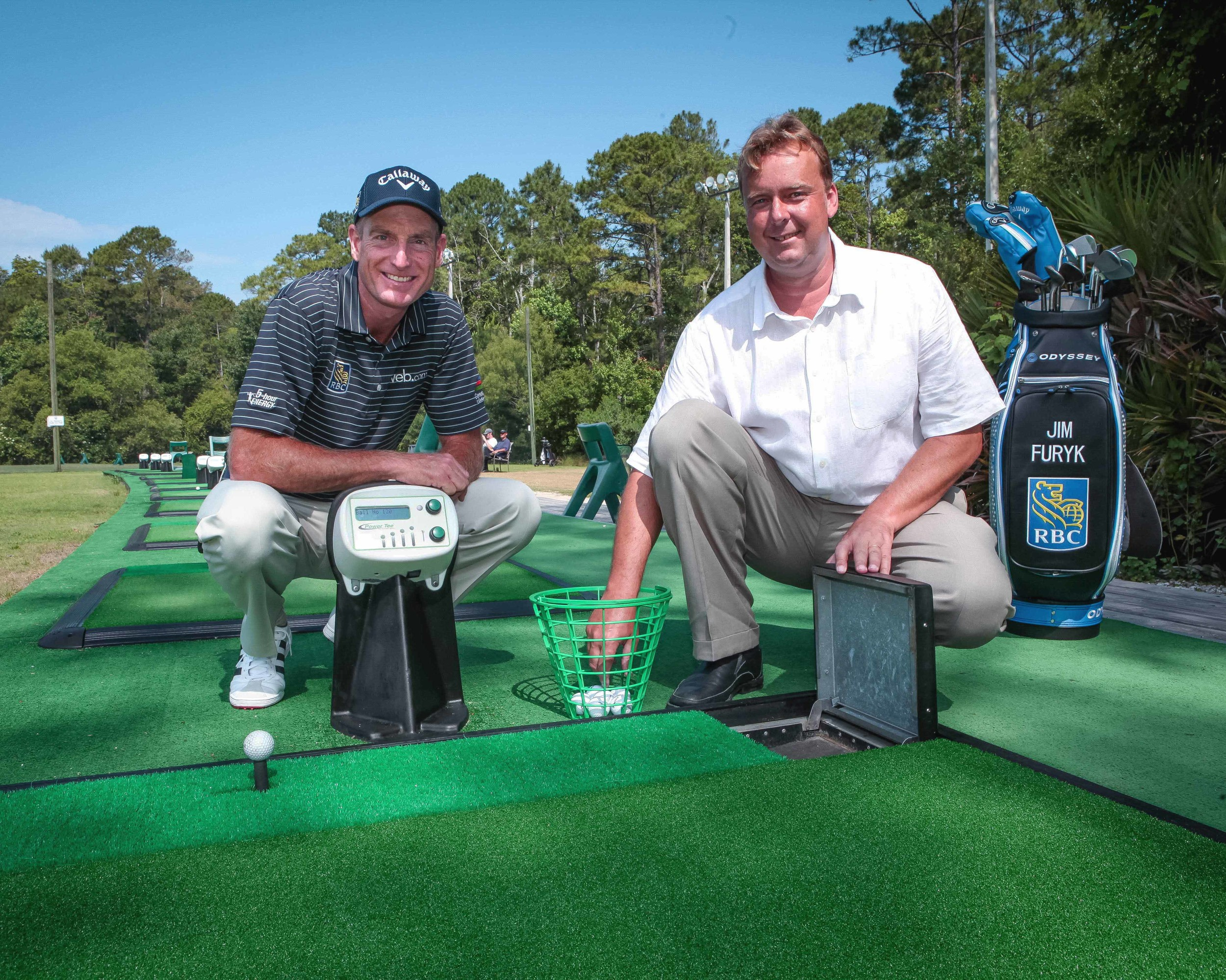 Jim Furyk kneels next to a Power Tee with Martin Wyeth at the Hayt Golf Learning Center at University of North Florida.