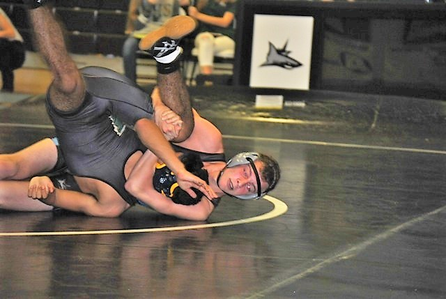 Ponte Vedra's Harrison Crowley wrestling Nease's Thomas Taylor in the 138-pound weight class bout, which Crowley won via pin