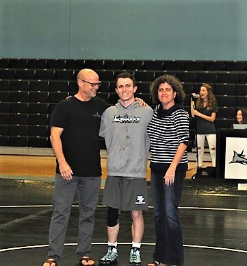 Ponte Vedra senior wrestler James Stanton with his parents during the senior night recognition