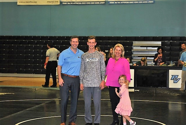 Ponte Vedra senior wrestler Harrison Crowley with his family during the senior night recognition