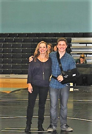 Ponte Vedra senior wrestler Marshall Frye with his mother during the senior night recognition