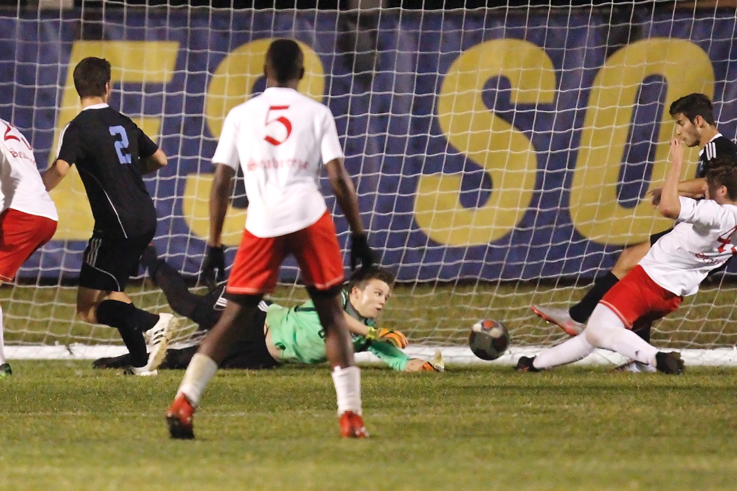 Shark keeper Brian Salzman makes a valiant but futile effort to stop the Seabreeze game-winning goal.