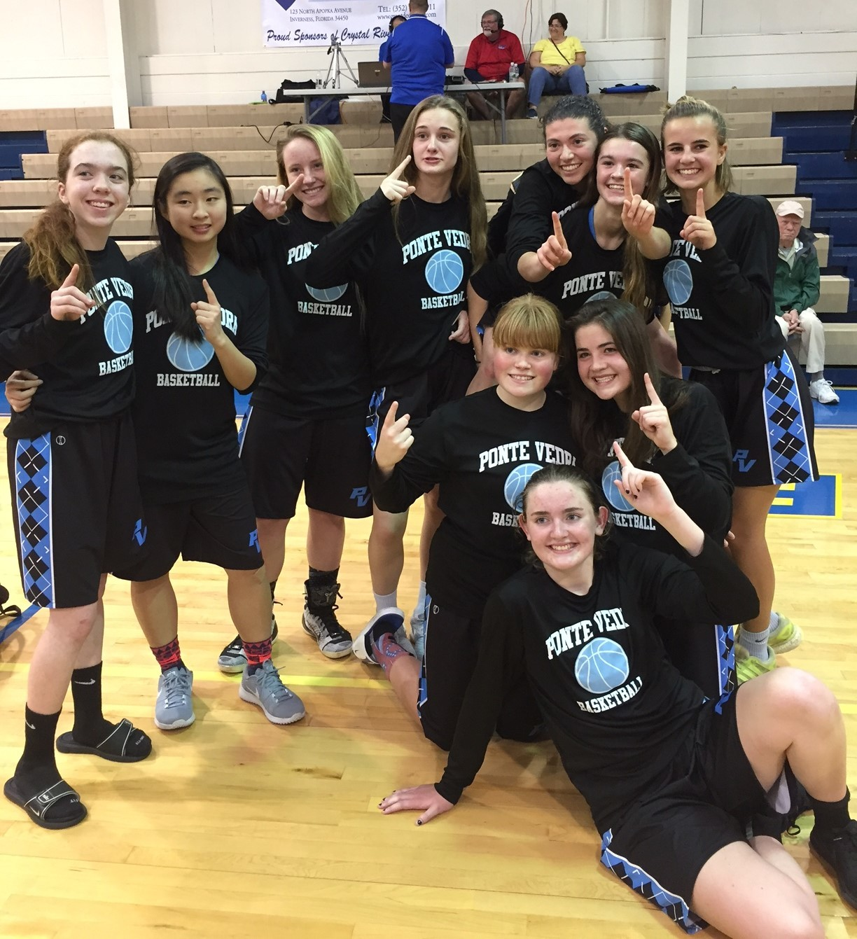 The Ponte Vedra girls basketball team celebrates after a regional final victory against Crystal River