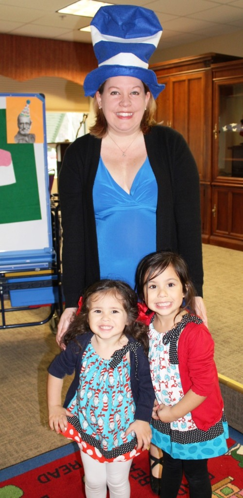 Youth Services Librarian Anne Crawford with sisters Emma and Elsie after our Dr. Seuss Pre-K Storytime Class