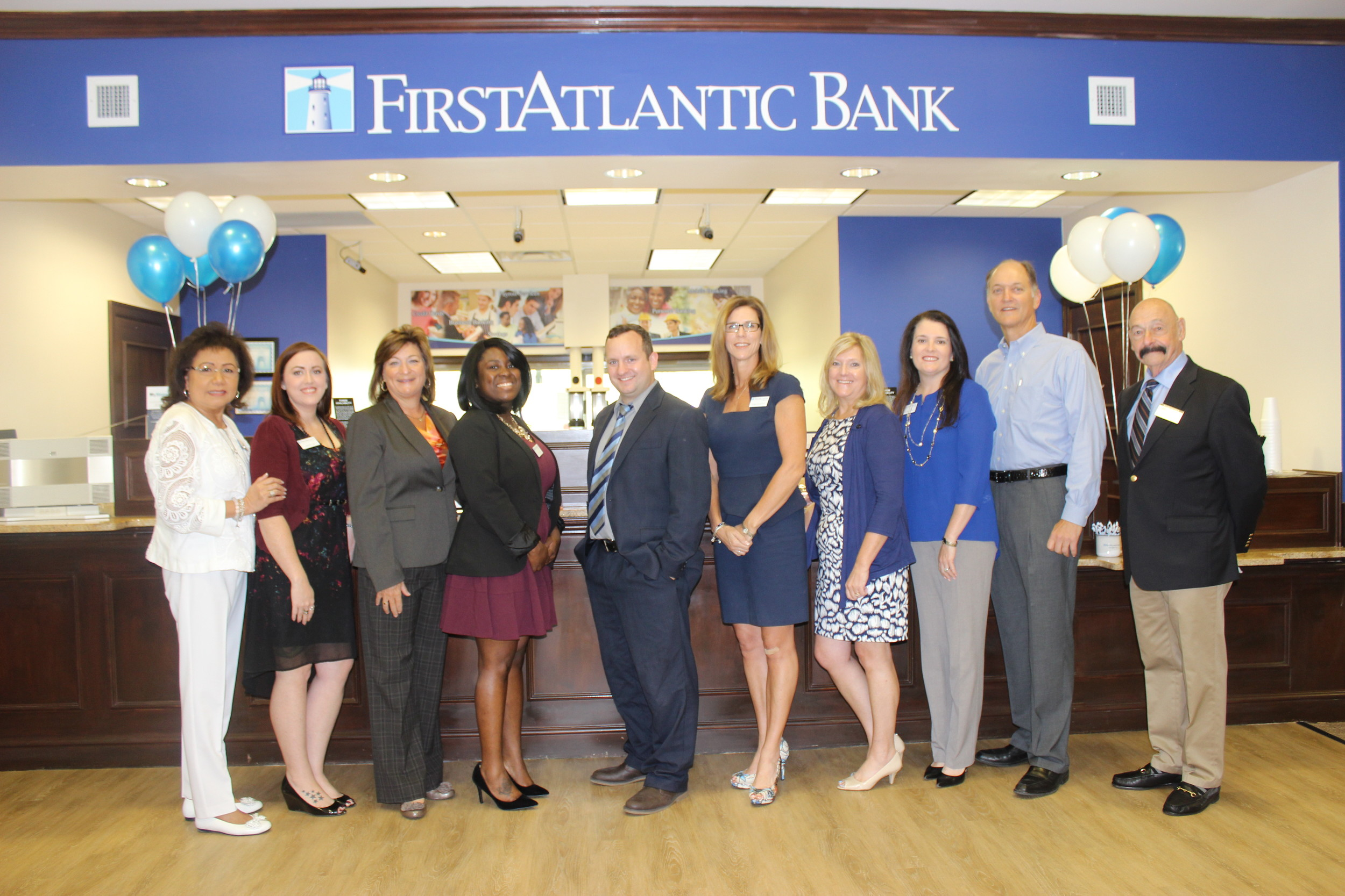 "First Atlantic Bank staff members join Ed Mercel (right), chairman of the board of directors for the St. Johns County Chamber of Commerce PVB Division, at the ""Before Hours"" social gathering March 8."