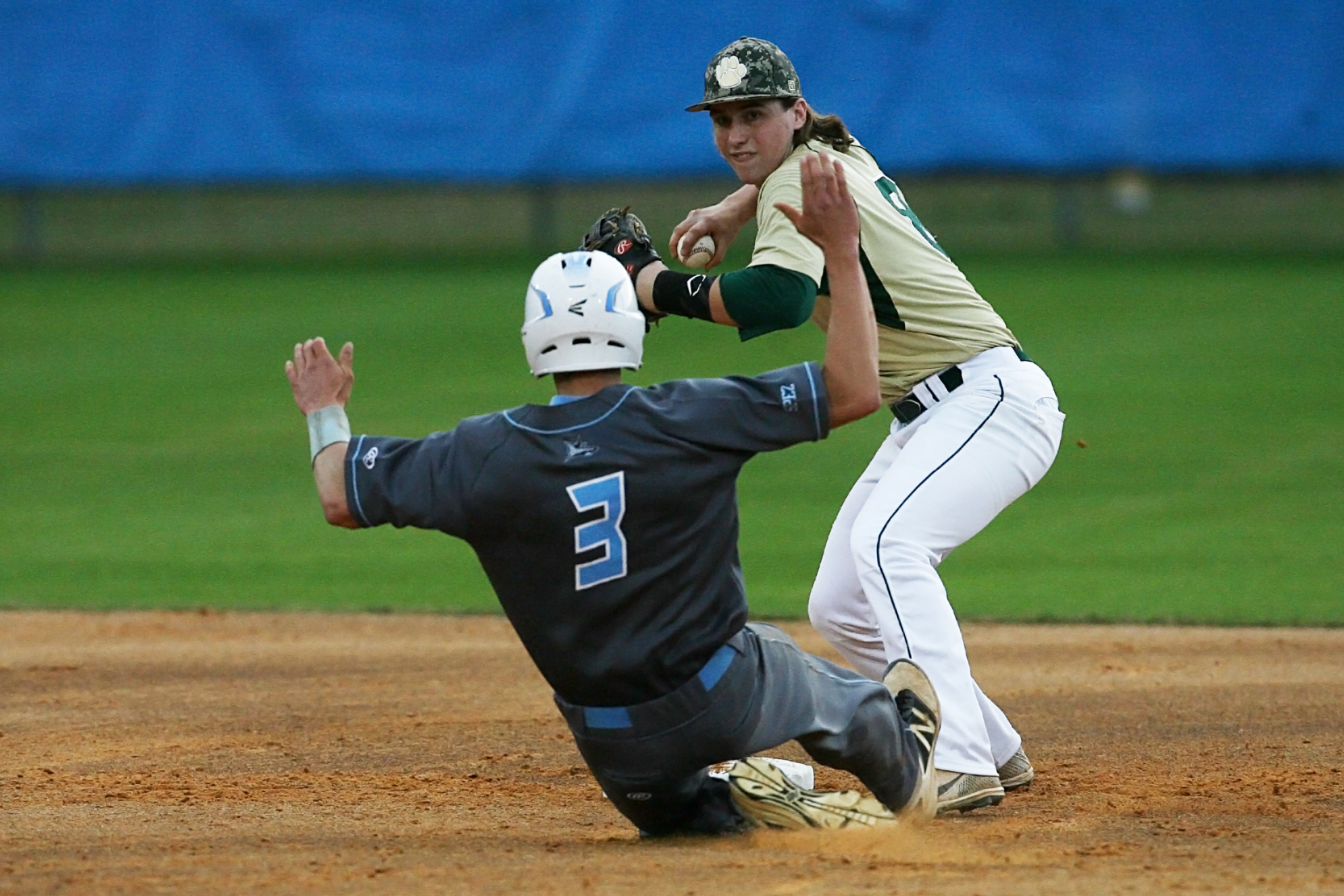 Quinton Brehm is forced out at the front end of a Nease double play. #8 Sean Duncan of the Panthers throws to first to complete the DP