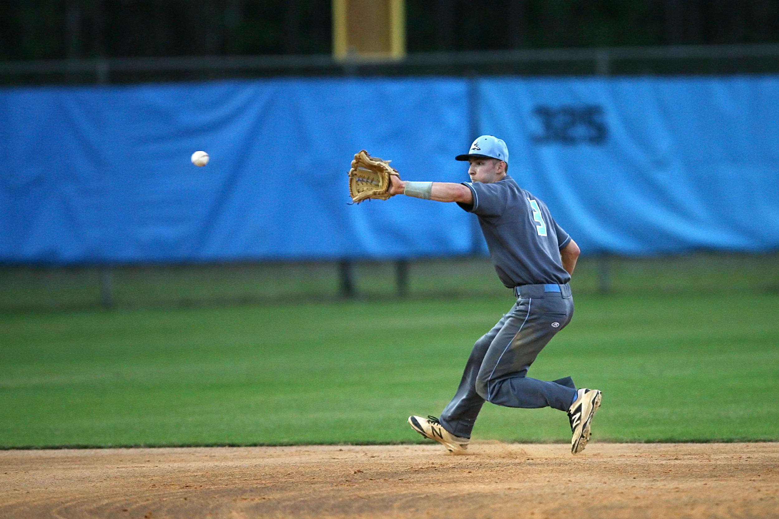 Sharks shortstop Quinton Brehm, #3 pulls in a Panther bid for a base hit.