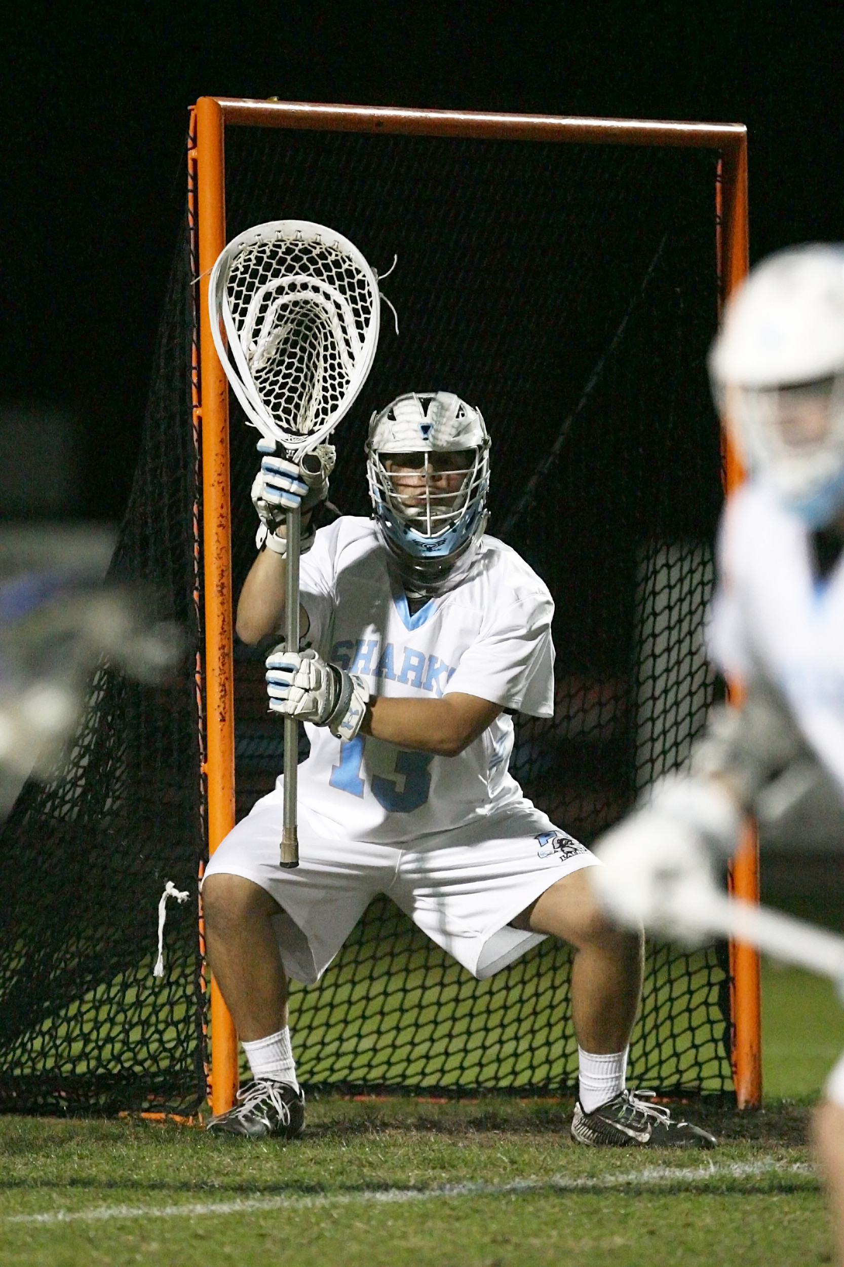 Shark goalie, Wyatt Shupler, is at the ready for a shot by Bartram Trail.