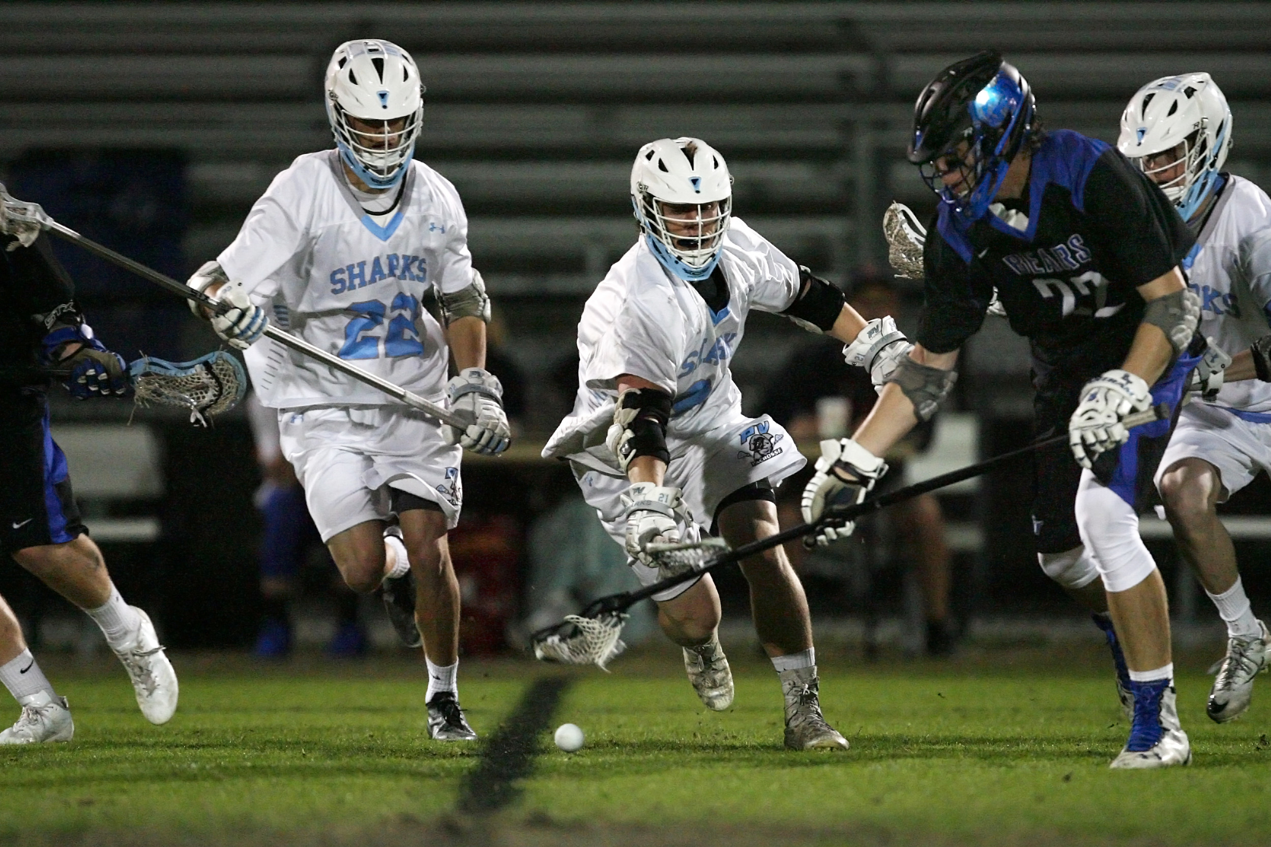 #22 Tommy Zitello and Andrew O'Dare battle for control of the loose ball.