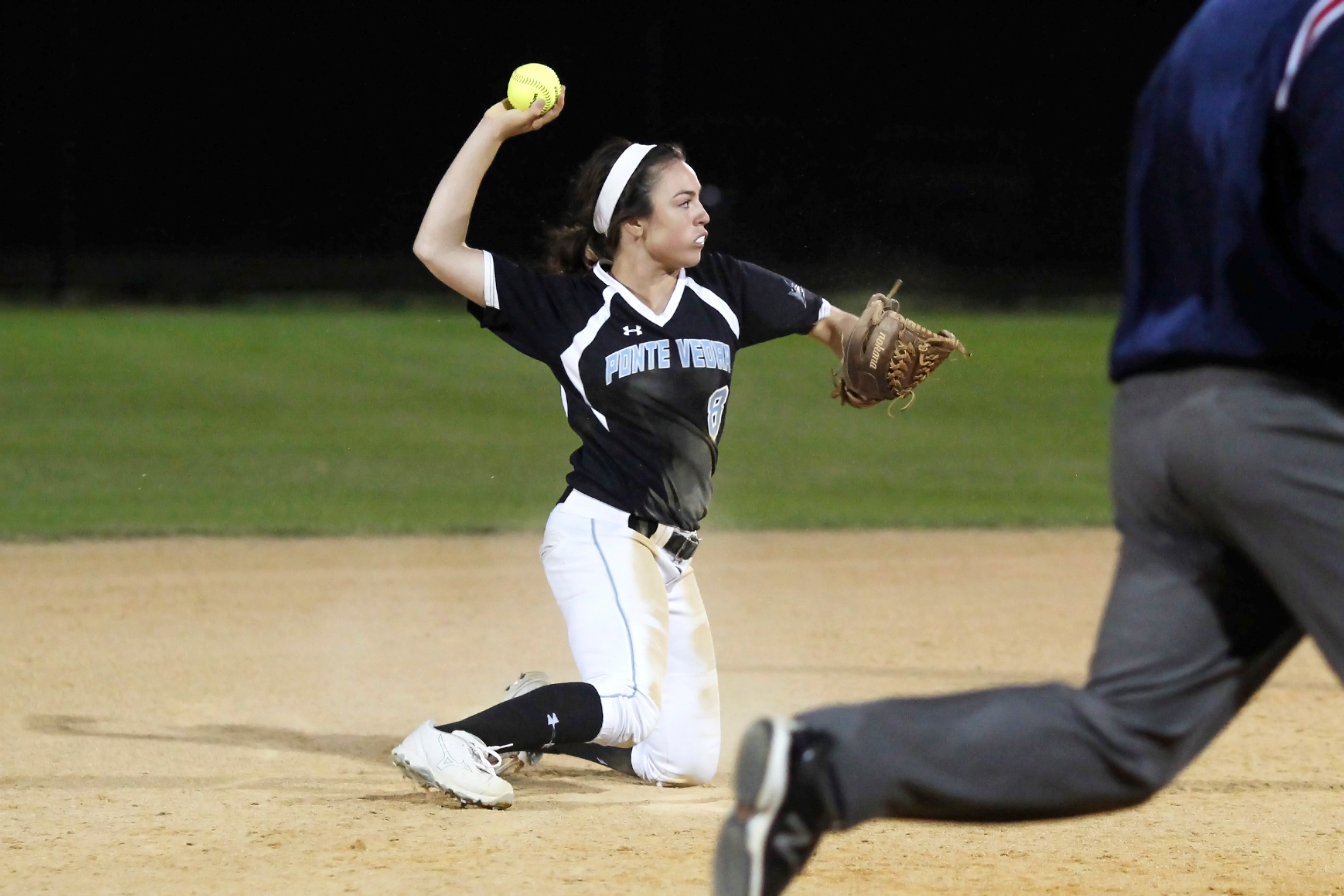 #8 Michelle Leone throws from her knees to get the force out