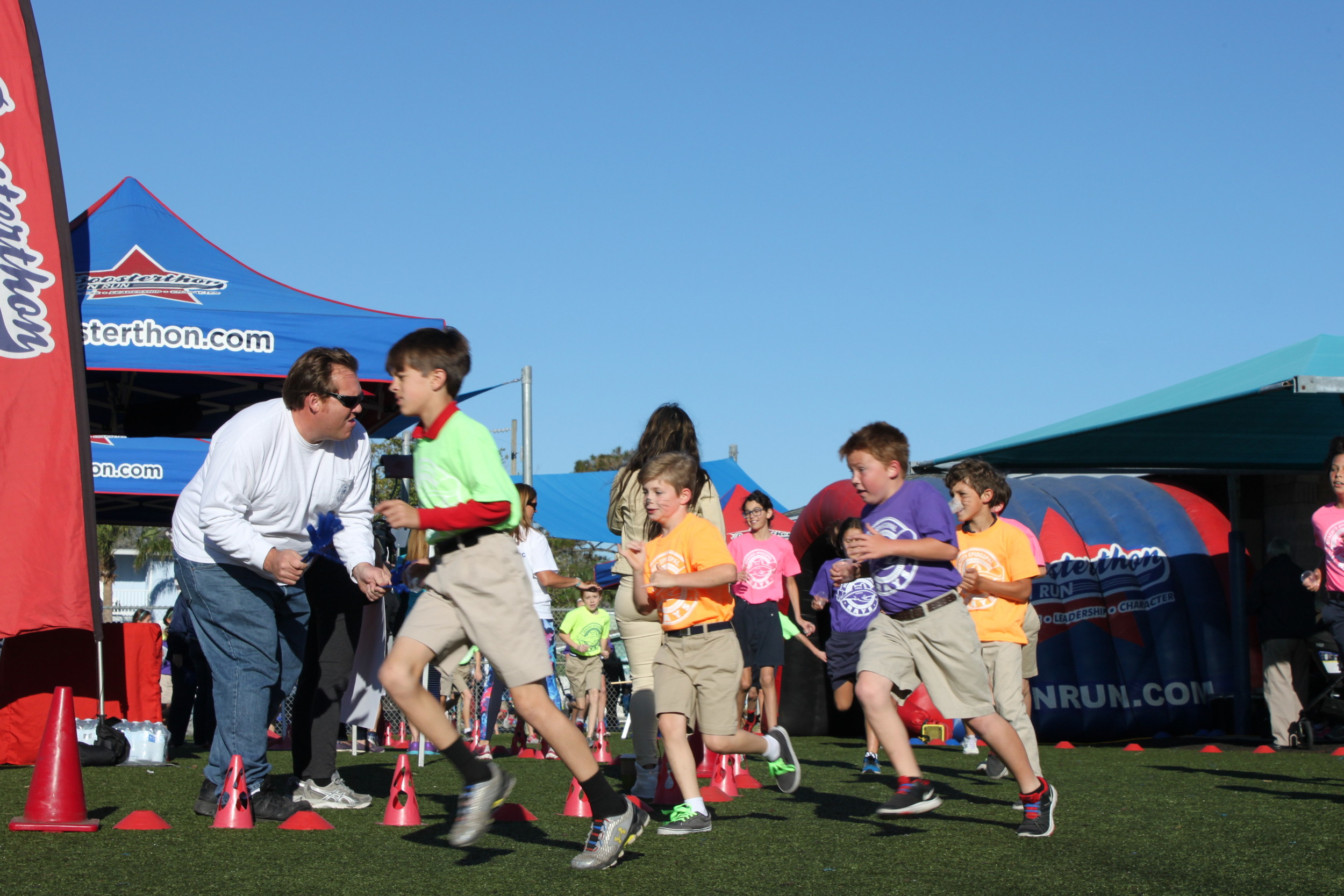 Beaches Episcopal School students run in the Boosterthon Fun Run event.