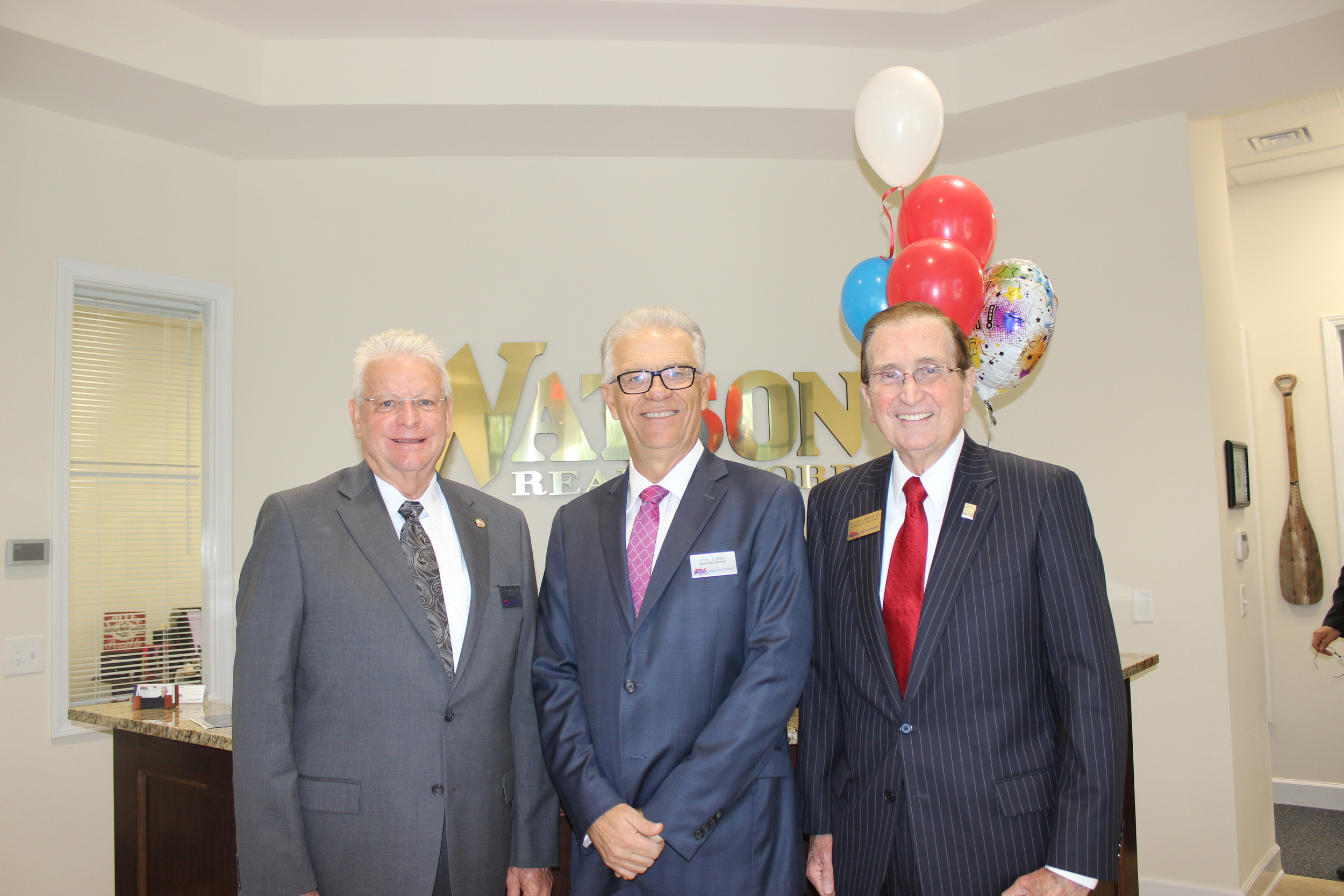Watson President Ed Forman, Nocatee Office Managing Broker Phil Lamb and company Founder and Board Chair William Watson Jr.