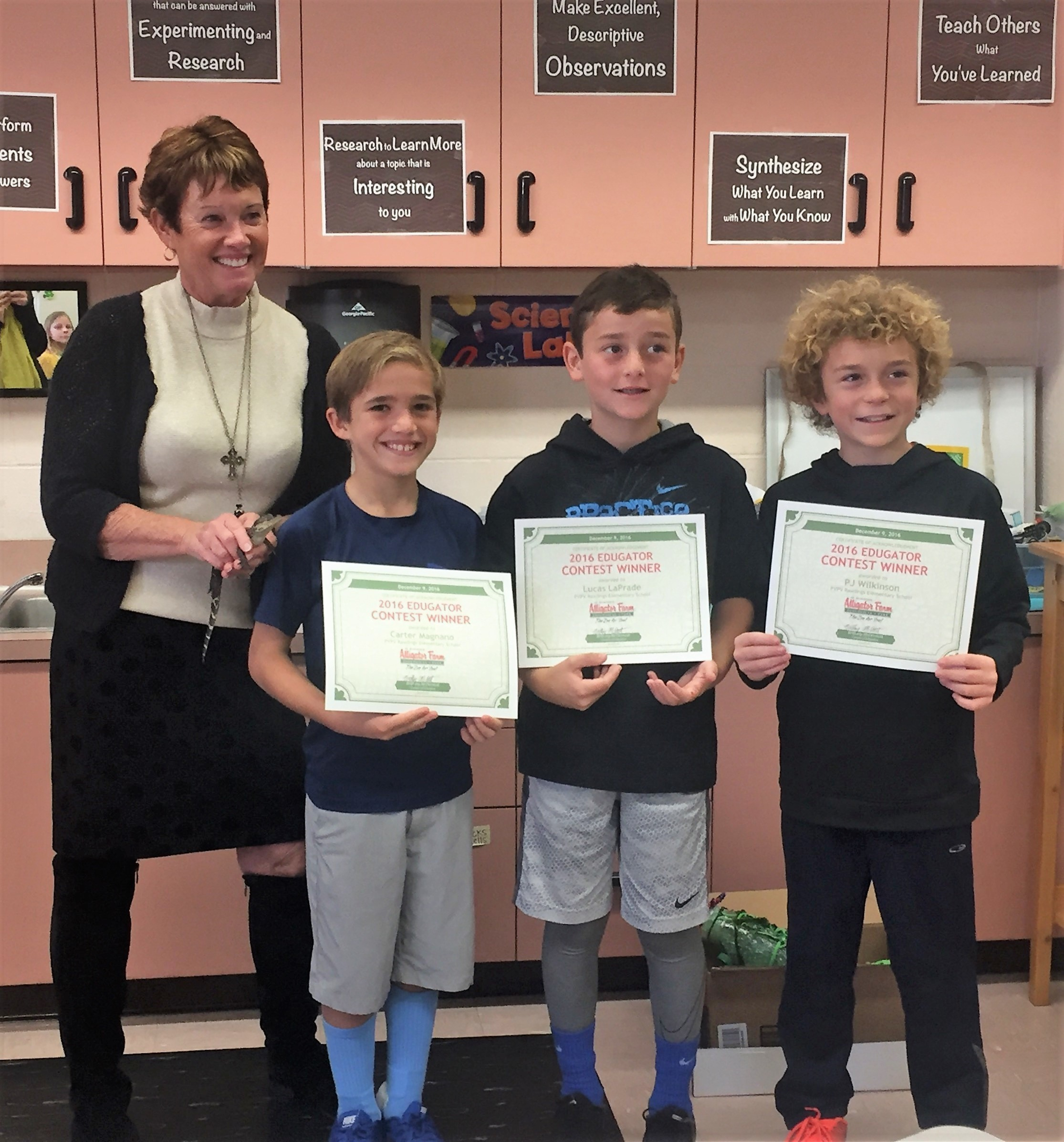 Mrs. Wetmore poses with Carter Magnano, Lucas Laprade and PJ Wilkinson after they received their certificates