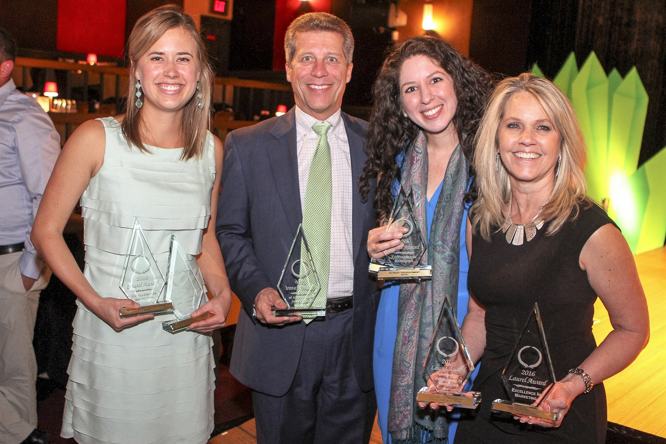 The PARC Group President Rick Ray and the firm's marketing team display some of the awards Nocatee's master developer received at the recent Laurel Awards.