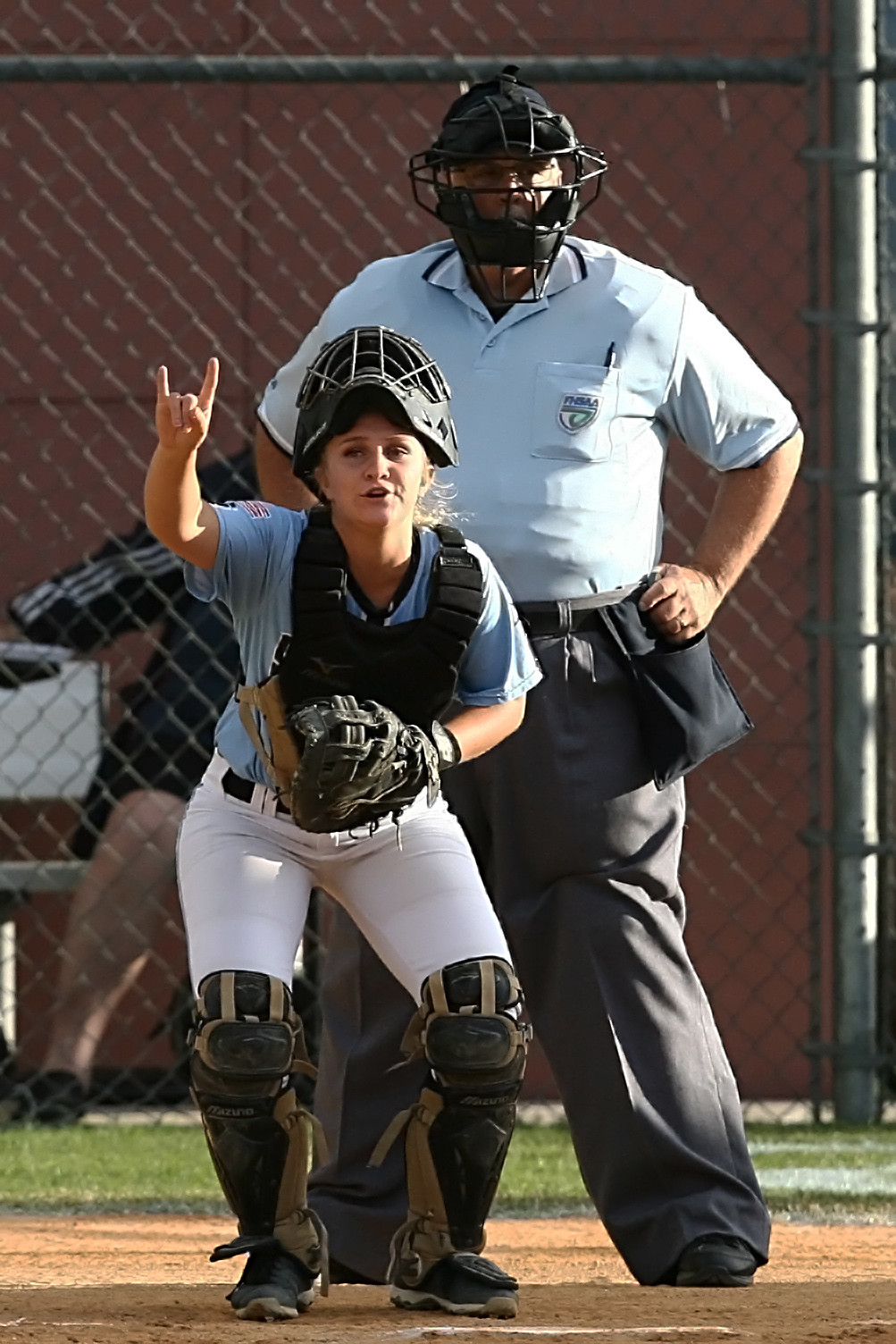 Shark catcher Taylor Bradshaw signals to her teammates that there are two outs in the inning.