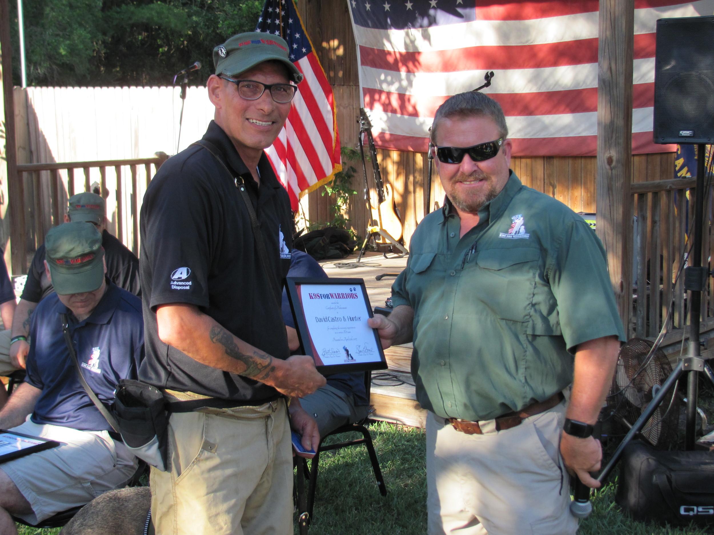 David Castro receives his graduation certificate from K9s for Warriors' Brett Simon.