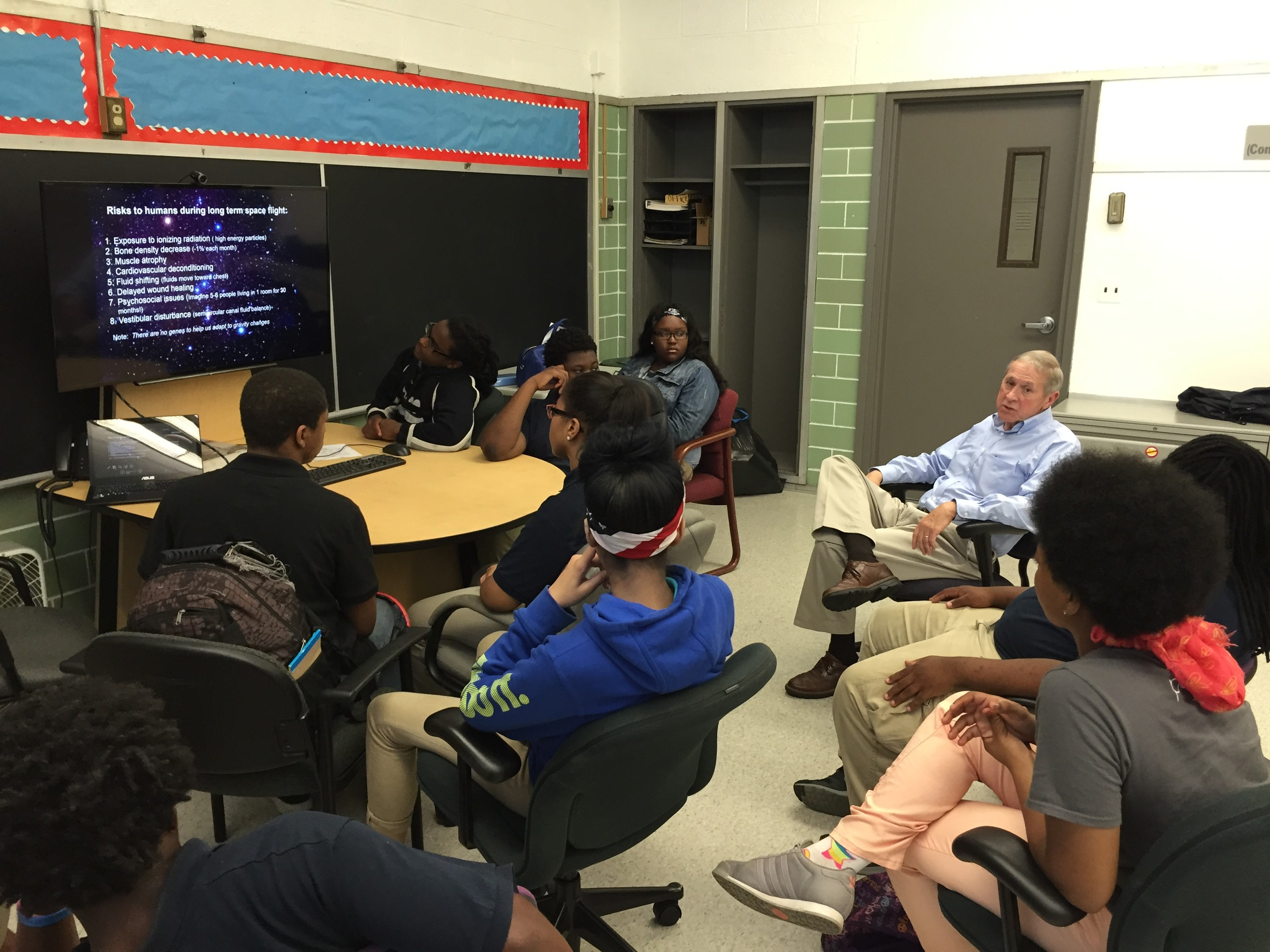 Orion's Quest Founder and Executive Director Peter Lawrie discusses a project with students at Cody High School in Michigan.