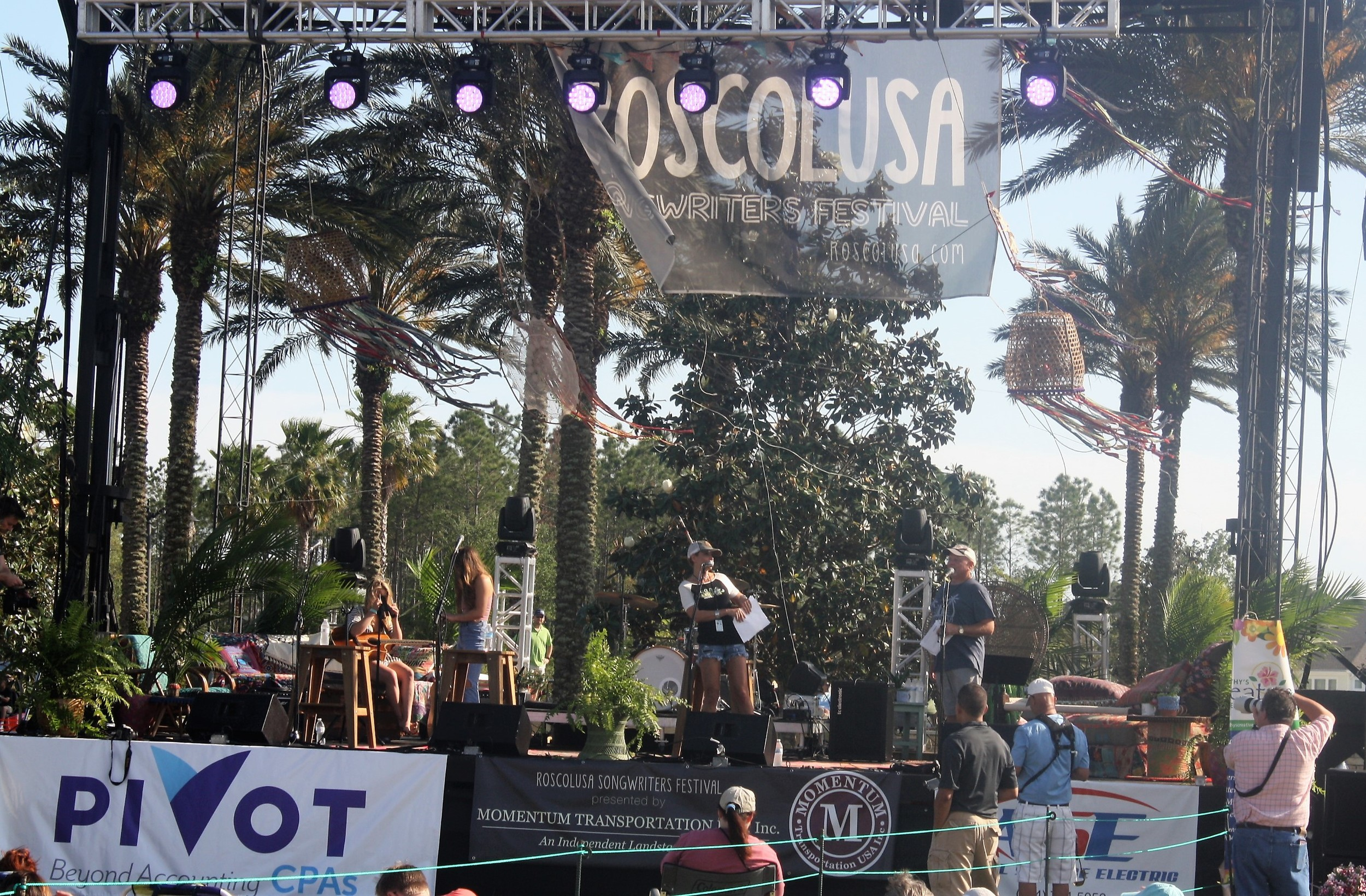 Gator Country DJ Eden Kendall welcomes attendees to the 6th Annual Roscolusa Songwriters Festival.