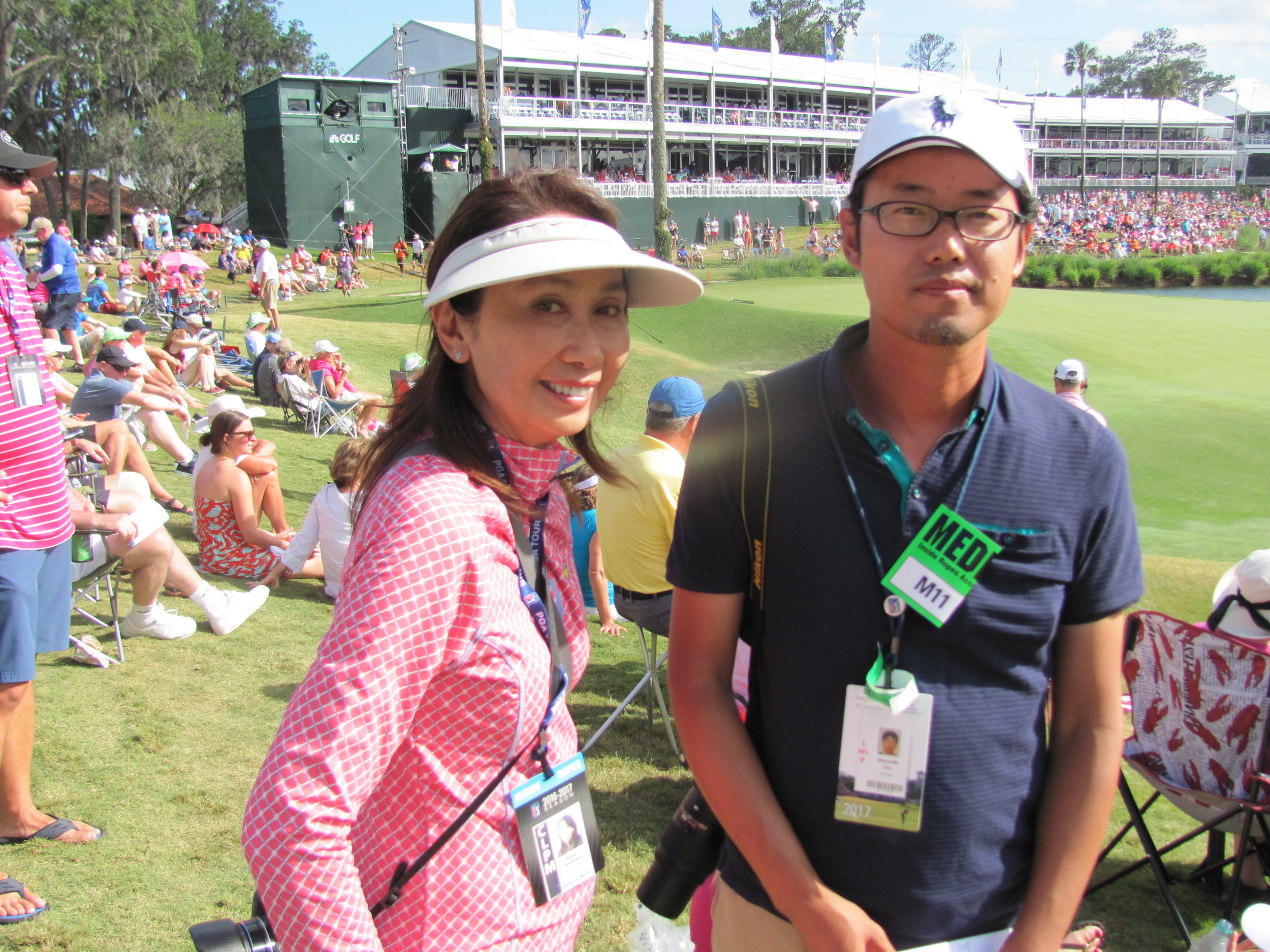 Japanese reporters Reiko Takekawa from Kyodo News and Shunsuke Ura from JiJi Press cover THE PLAYERS Championship.