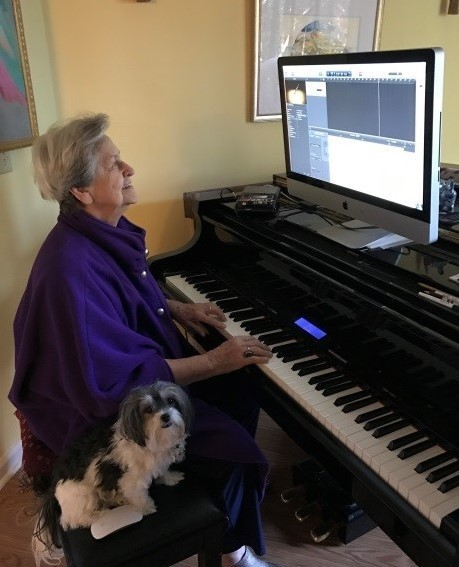 Bess Turk uses adaptive technology while playing the piano.