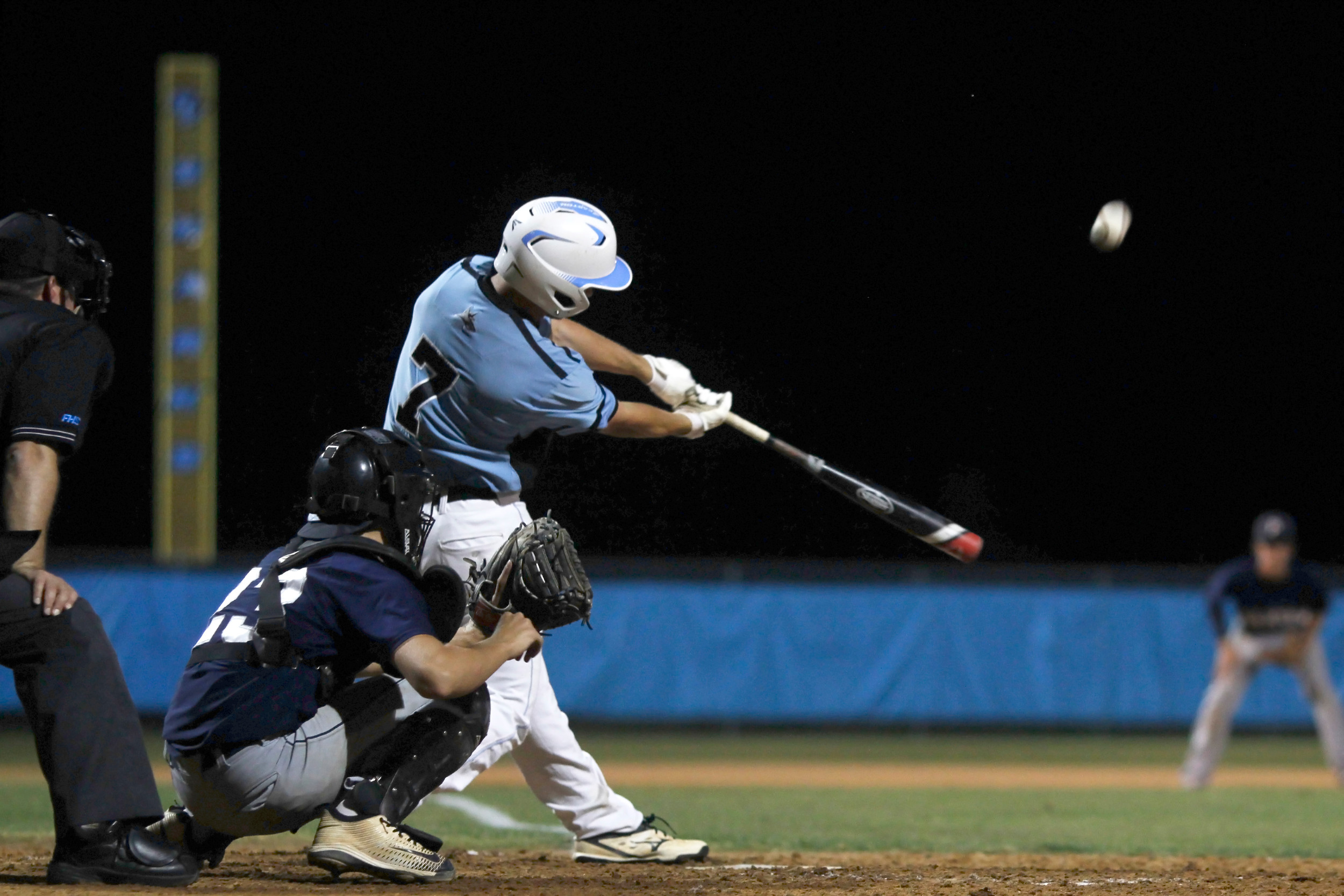Jack Hahnemann lines a base hit for the Sharks against Paxon.