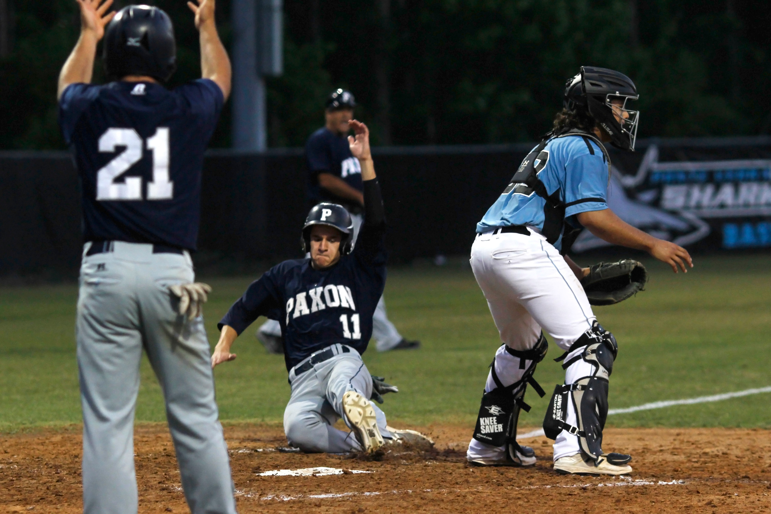 Shark catcher Frank Ferrante waits for the throw as the second Paxon run scores.