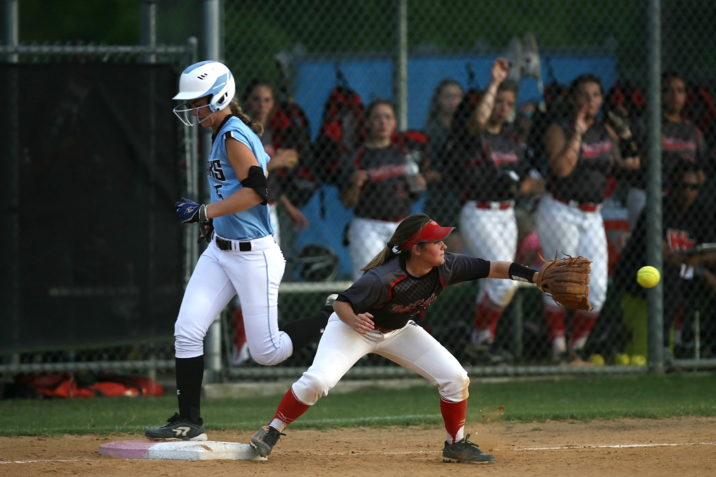Michelle Holder beats the throw to first for a base hit against West Florida.