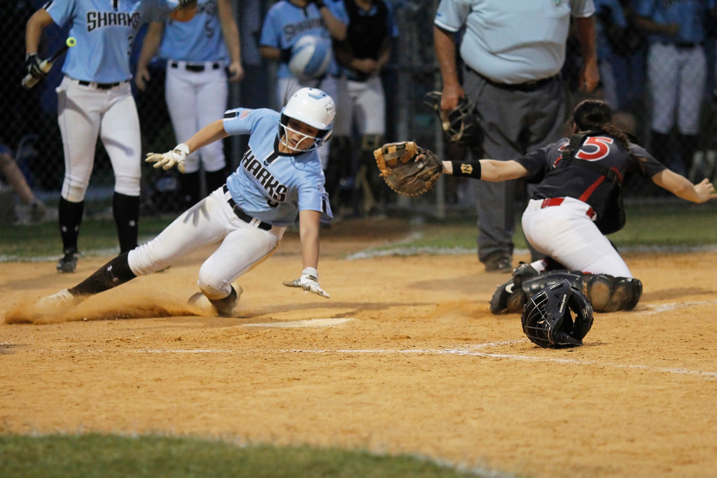 Michelle Leone slides home with the game winning run in the Sharks mercy win over West Florida.