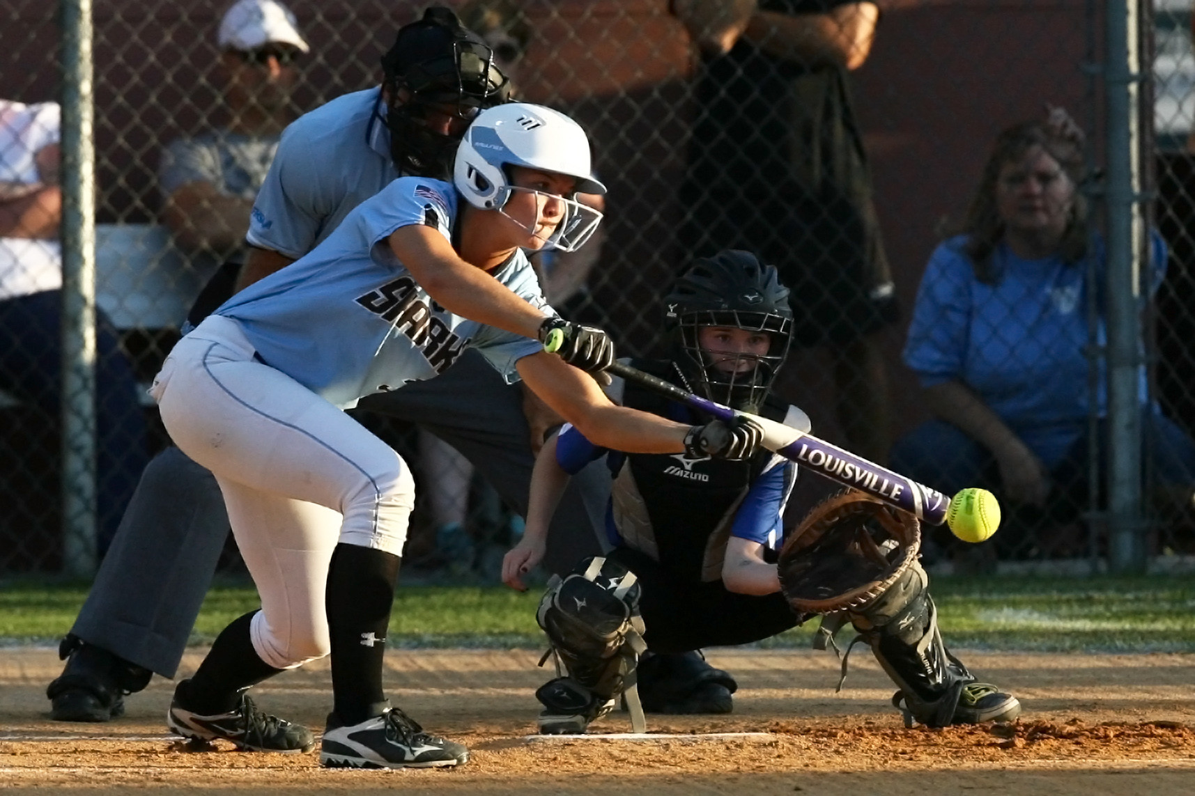 #3 Quinlan Richmond lays down a sacrifice bunt against Ridgeview.