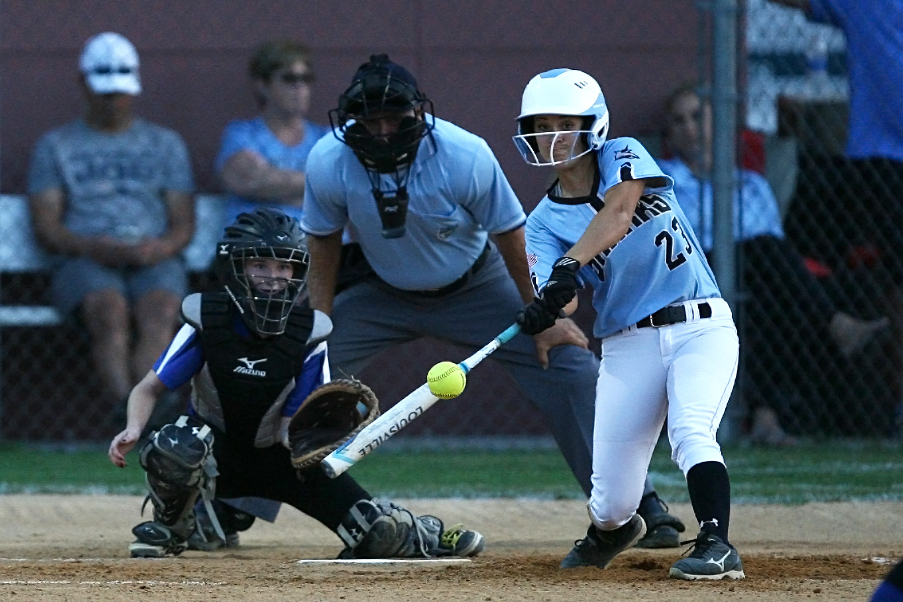 Kiley Hennessey lines a base hit for the Sharks against Ridgeview.